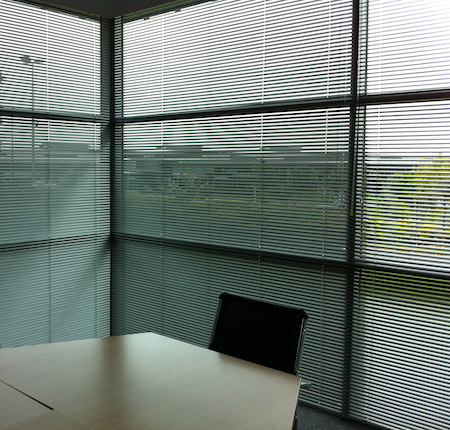 large aluminium blinds in an office boardroom
