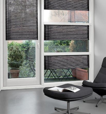 aluminium blinds in different shaped windows in living room