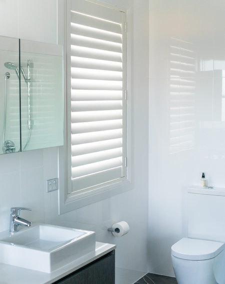 shutters in the bathroom to control light and privacy