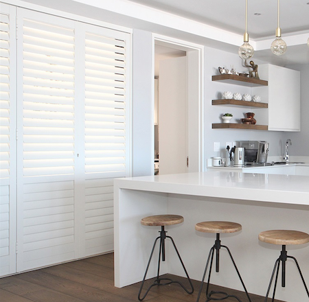 white sliding shutters in a modern kitchen environment