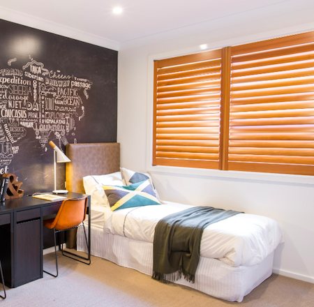 natural look timber shutters in a bedroom