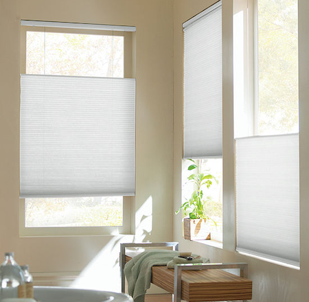 showing the versatility and control options of honeycomb blinds in the bathroom