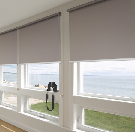 blockout blinds in a lounge conservatory with a seaside view