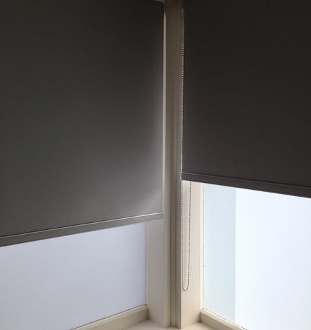 two blockout blinds in a bedroom