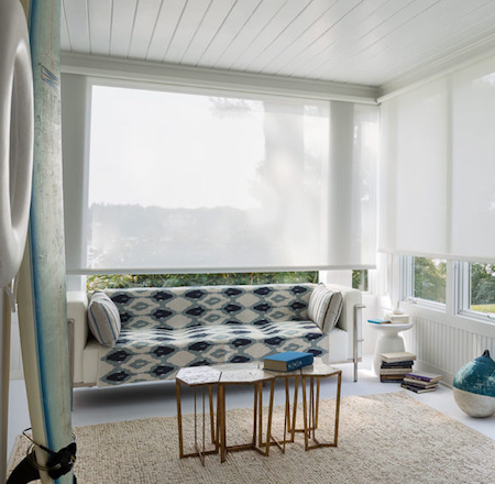seaside lounge room with white sunscreen blinds