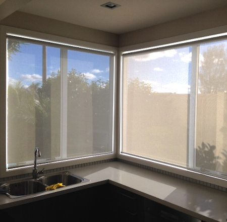 sunscreen blinds reducing glare in a kitchen