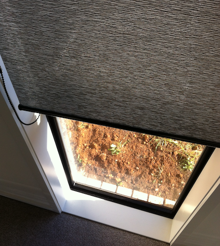 sheer roller blinds in a window space of a new home