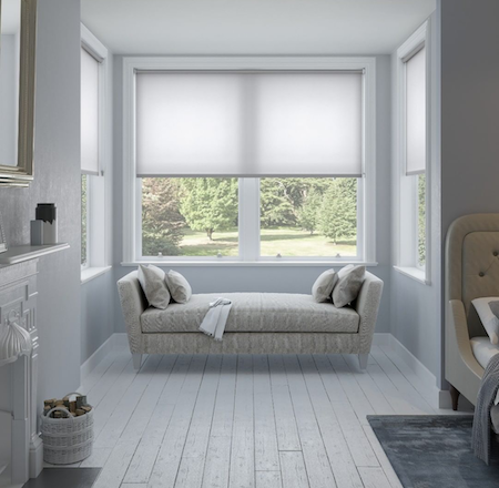 sheer roller blinds in bay window area of a home