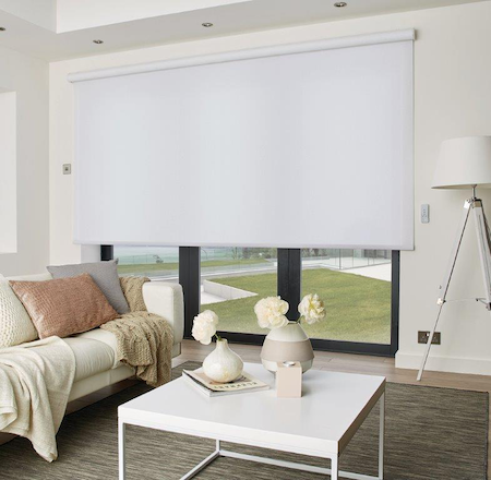 sheer roller blind over bifold doors in a homes lounge area