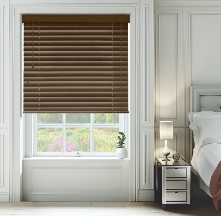 dark wood colour wooden blinds in the master bedroom