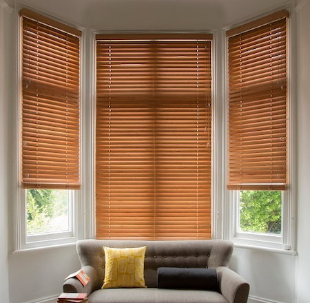 wooden blinds in a bay window area
