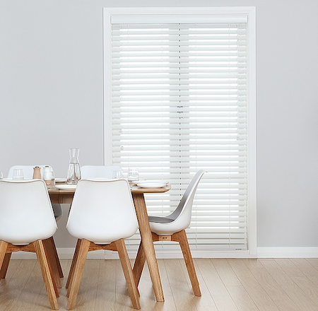 wooden blinds over french doors in a dining room