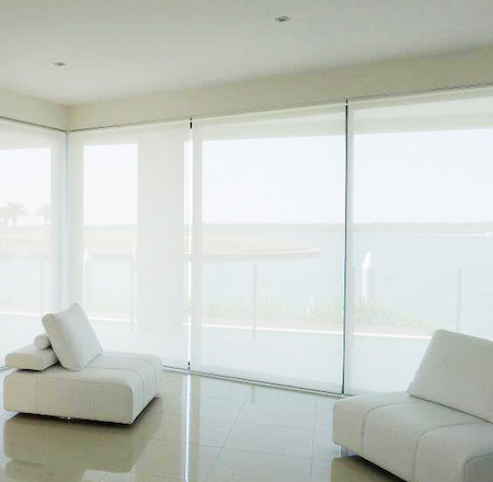 sunscreen blinds providing privacy and uv protection in a lounge with a view